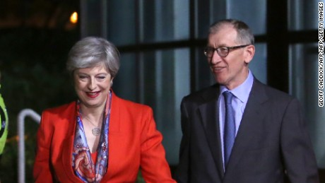 British Prime Minister Theresa May, left, arrives with her husband Philip  at the count centre in Maidenhead.