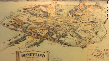 Mike Van Eaton stands next to the original map of Disneyland set for auction at his animation gallery in Sherman Oaks, California next month.
