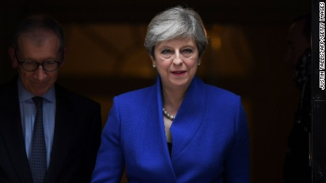 Britain's Prime Minister and leader of the Conservative Party Theresa May leaves 10 Downing Street in central London on June 9, 2017, en route to Buckingham Palace to meet Queen Elizabeth II, the day after a general election in which the Conservatives lost their majority. British Prime Minister Theresa May will on Friday seek to form a new government, resisting pressure to resign after losing her parliamentary majority ahead of crucial Brexit talks. May is set to meet the head of state Queen Elizabeth II and ask for permission to form a new government, according to her Downing Street office. / AFP PHOTO / Justin TALLIS        (Photo credit should read JUSTIN TALLIS/AFP/Getty Images)