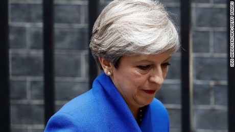 Britain's Prime Minister and leader of the Conservative Party Theresa May leaves 10 Downing Street in central London on June 9, 2017, en route to Buckingham Palace to meet Queen Elizabeth II, the day after a general election in which the Conservatives lost their majority.