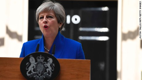 Britain's Prime Minister and leader of the Conservative Party Theresa May delivers a statement outside 10 Downing Street in central London on June 9, 2017 as results from a snap general election show the Conservatives have lost their majority.
