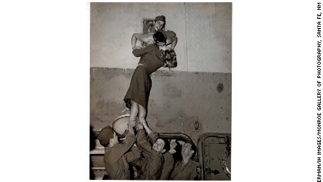 Marlene Dietrich passionately kisses a GI as he arrives home to New York from World War II in 1945.