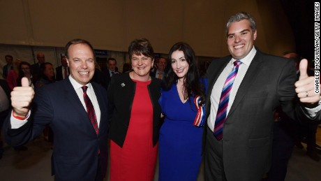 DUP leader Arlene Foster, DUP deputy leader and north Belfast candidate Nigel Dodds, Emma Little Pengelly  DUP south Belfast candidate and Gavin Robinson DUP east Belfast candidate celebrate at the Belfast count centre on June 9, 2017 in Belfast.