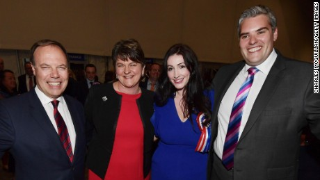 BELFAST, NORTHERN IRELAND - JUNE 09: DUP leader Arlene Foster (2nd L), DUP deputy leader and north Belfast candidate Nigel Dodds (L), Emma Little Pengelly (2nd R) DUP south Belfast candidate and Gavin Robinson (R) DUP east Belfast candidate celebrate at the Belfast count centre on June 9, 2017 in Belfast, Northern Ireland. After a snap election was called the United Kingdom went to the polls yesterday, after a closely fought election the results from across the country are being counted and an overall result is expected in the early hours. (Photo by Charles McQuillan/Getty Images)