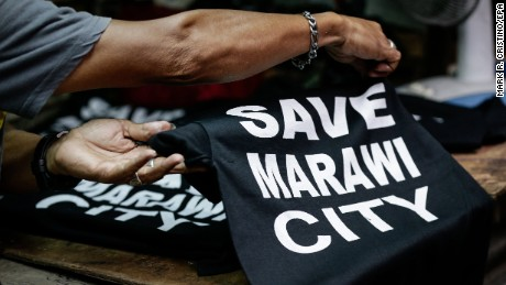 """Save Marawi City"" T-shirts are sold in Manila to help  victims of the fighting."