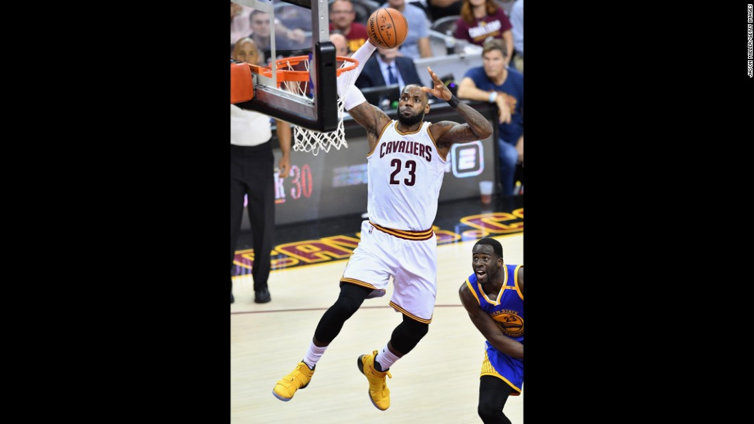 James dunks the ball during Game 4. The Cavaliers scored a Finals-record 86 points in the first half. They also made 24 3-pointers in the game, a Finals record and just one away from the all-time league record.