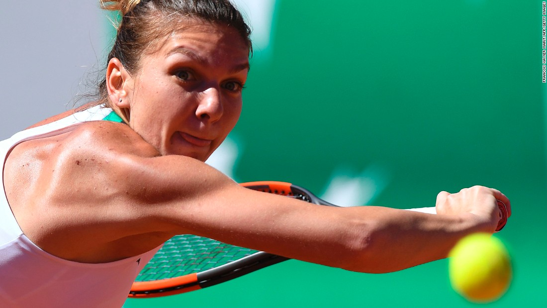 Simona Halep backhands the ball back to Ostapenko. The Romanian possesses a counter-punching game and against Ostapenko could do nothing but react to her opponent's booming ground strokes.