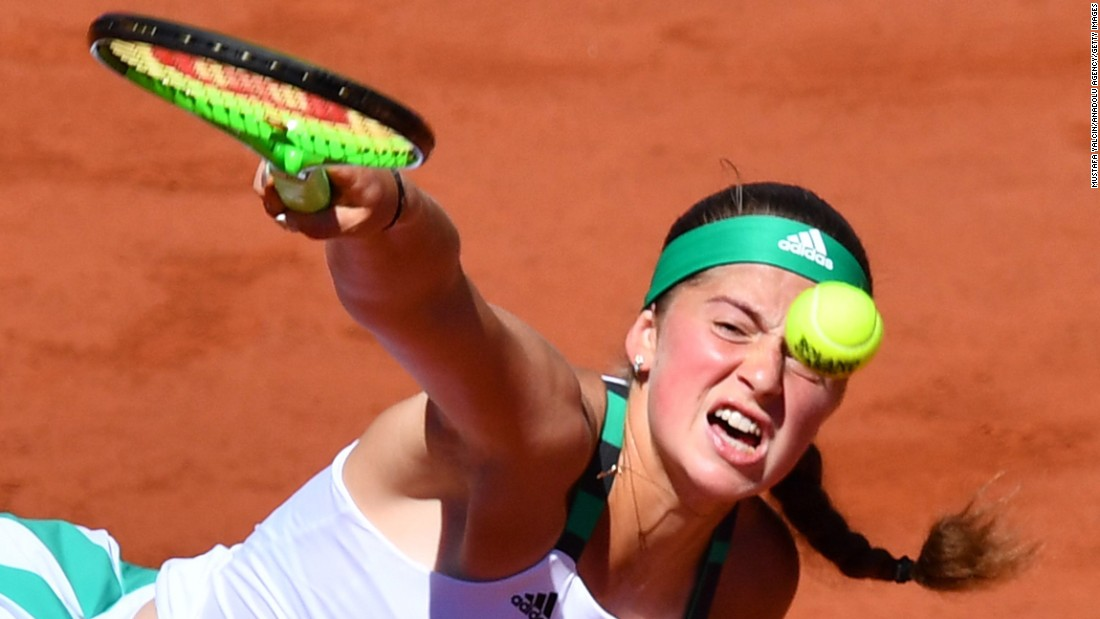 Jelena Ostapenko of Latvia smashes an overhand return.
