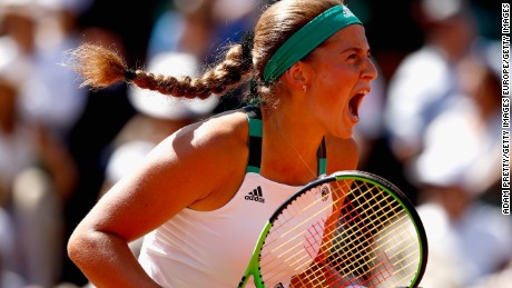 Jelena Ostapenko celebrates during the French Open final against Romania's Simona Halep.