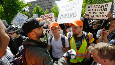 Opposing sides argue during an anti-Islamic law protest rally Saturday, June 10, 2017, in Seattle. (AP Photo/Ted S. Warren)