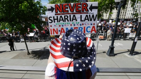 Cathy Camper of Tacoma, Washington, wears a stars-and-stripes cowboy hat as she rallied against Islamic law in Seattle.