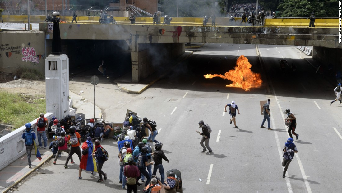 Demonstrators clash with riot police in Caracas on Saturday, June 10.