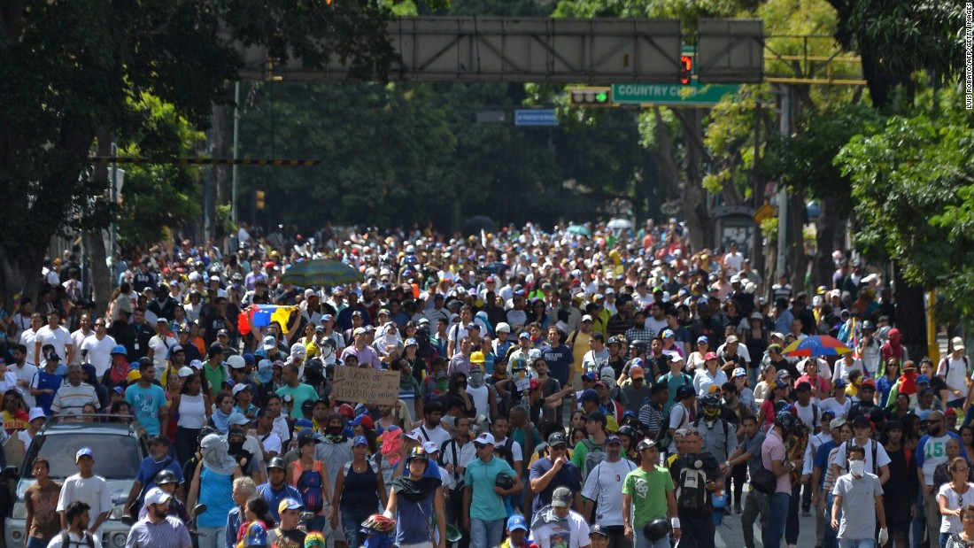 Venezuelan students and other demonstrators gather outside the National Telecommunications Commission in Caracas on Friday, June 9. Protesters were calling for an end to media censorship in the country.
