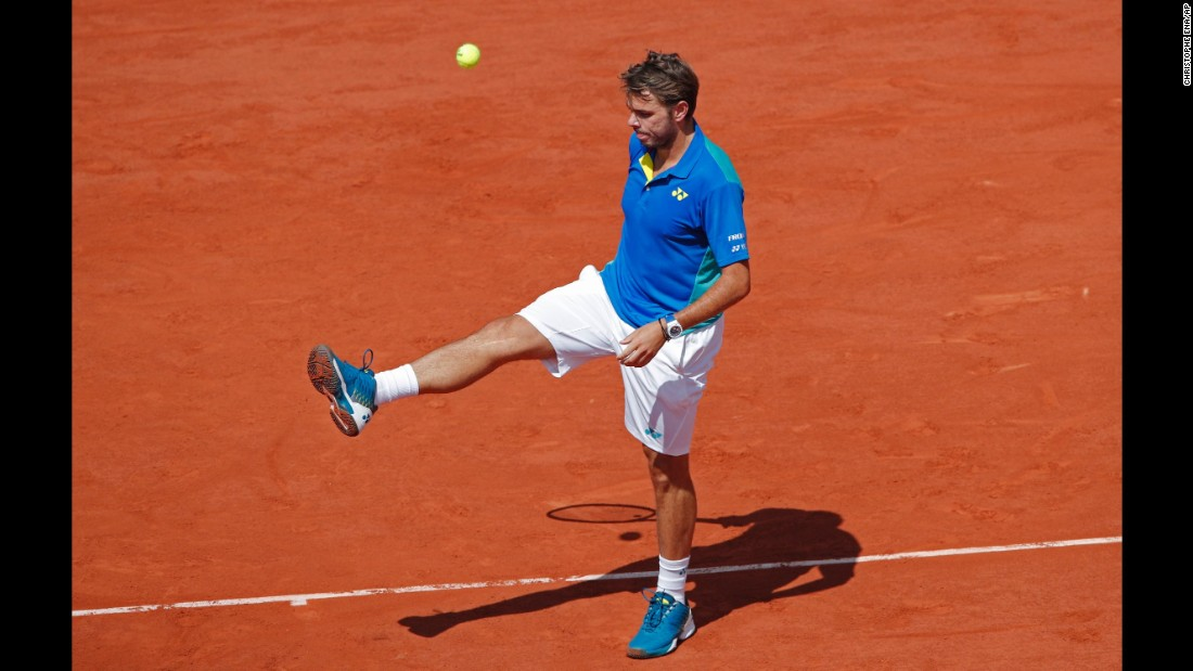 Wawrinka kicks a ball during his comprehensive loss to Nadal.