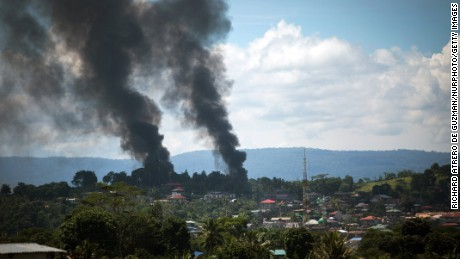 Smoke billows after air strikes by Philippine forces in Marawi City on Sunday.