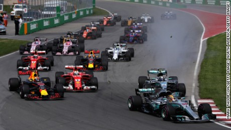 Lewis Hamilton (No. 44) leads into Turn One at the start of the Canadian Grand Prix.