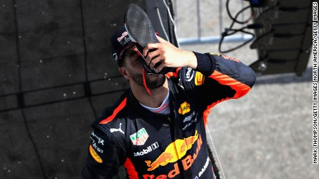 "Daniel Ricciardo reprises his ""shoey"" celebration on the podium in Montreal."