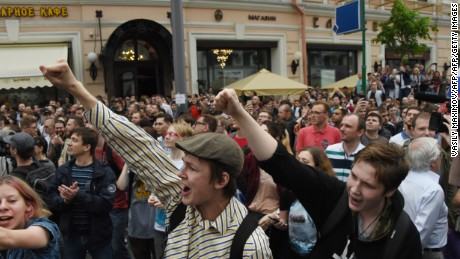 "People chant slogans during an unauthorized opposition rally in Moscow on June 12, 2017. Over 200 people were detained on June 12, 2017 by police at opposition protests called by Kremlin critic Alexei Navalny, said a Russian NGO tracking arrests. ""About 121 people were detained in Moscow up to this point. In Saint-Petersburg - 137,"" OVD-Info group, which operates a detention hotline, wrote on Twitter.  / AFP PHOTO / VASILY MAXIMOV        (Photo credit should read VASILY MAXIMOV/AFP/Getty Images)"