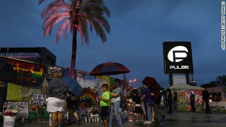 People visit the memorial to the victims of the mass shooting setup around the Pulse gay nightclub one day before the one year anniversary of the shooting on June 11, 2017 in Orlando, Florida. Omar Mateen killed 49 people at the club a little after 2 a.m. on June 12, 2016.