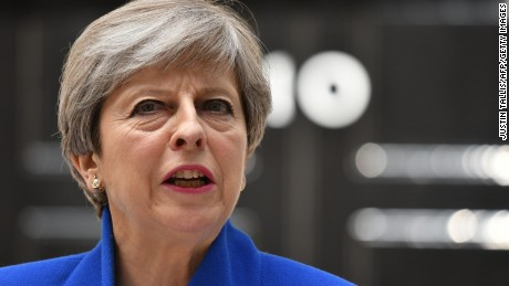 Britain's Prime Minister and leader of the Conservative Party Theresa May, makes a statement outside 10 Downing Street in central London on June 9, 2017 as results from a snap general election show the Conservatives have lost their majority.