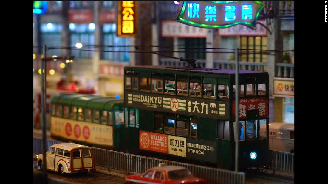 A close-up shot depicts a tram running past the pier on Hong Kong's Connaught Road.