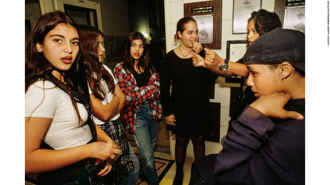 Kim Kardashian, 12, and Kourtney (third from left), 13, at a school dance in Bel-Air, Los Angeles in 1992.