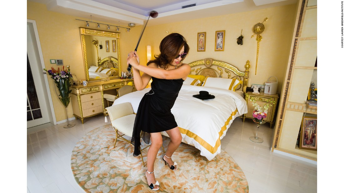 "Lauren Greenfield documented the American dream for 25 years, fascinated by money, fame and how people try to mimic the way rich people live. In her new book, ""Generation Wealth,"" she also looks at how the tropes of the rich have been exported internationally. (Here, businesswoman Xue Qiwen poses in her Shanghai apartment, decorated with Versace furniture.)"