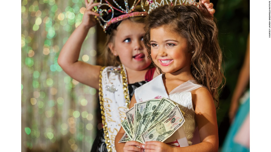 "Kailia Deliz, 5, receives her cash award for winning the Ventura County ""Summer Fun"" Beauty Pageant in 2011."