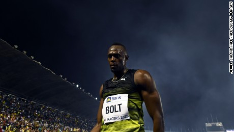 Usain Bolt (C) of Jamaica leaves the track after winning his final race in home country during the Racers Grand Prix at the national stadium in Kingston, Jamaica, on June 10, 2017. Bolt partied with his devoted fans in an emotional farewell at the National Stadium on June 10 as he ran his final race on Jamaican soil. Bolt is retiring in August following the London World Championships. / AFP PHOTO / Jewel SAMAD        (Photo credit should read JEWEL SAMAD/AFP/Getty Images)