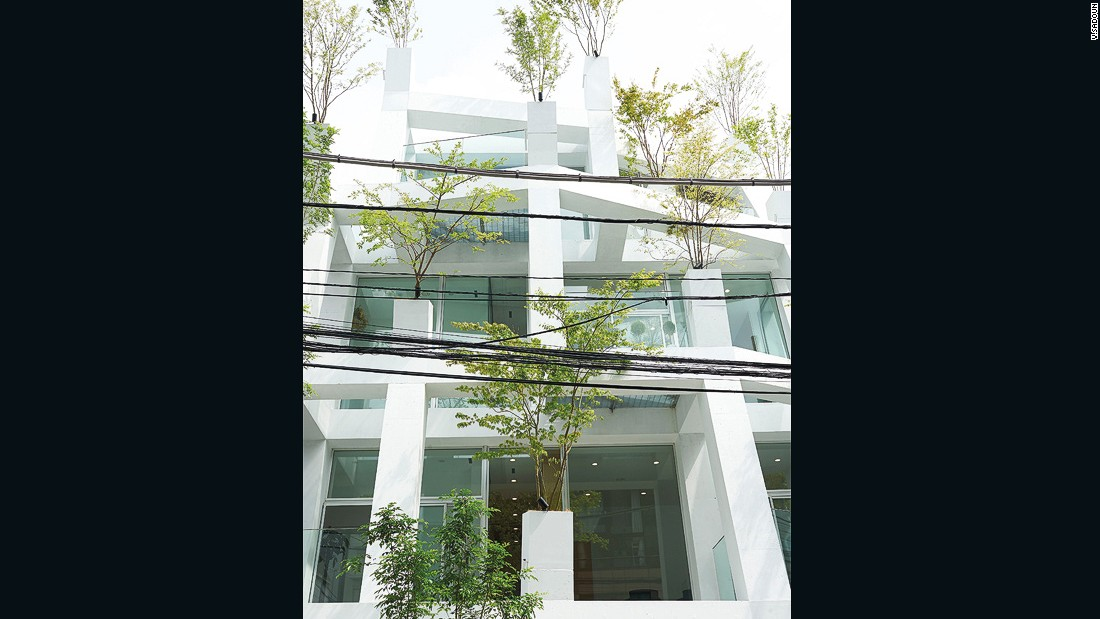 Sou Fujimoto designed this building, located in the back alleys of Omotesando  in Tokyo, to create a new fusion between the built environment and nature. Trees are placed on the end of the concrete frame, to make it appear as if real trees are sprouting out of an artificial one.