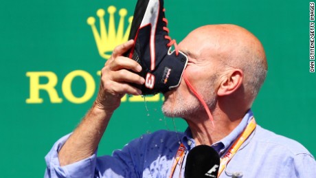 MONTREAL, QC - JUNE 11:  Daniel Ricciardo of Australia and Red Bull Racing celebrates on the podium with Patrick Stewart and a shoey after finishing third in the Canadian Formula One Grand Prix at Circuit Gilles Villeneuve on June 11, 2017 in Montreal, Canada.  (Photo by Dan Istitene/Getty Images)