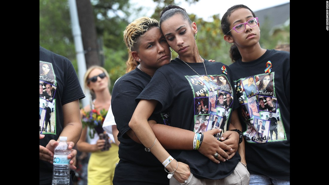 Angel Ayala, left, and Carla Montanez mourn the loss of their best friend.