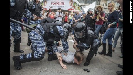 Police detain a protester In Moscow, Russia, Monday, June 12, 2017.