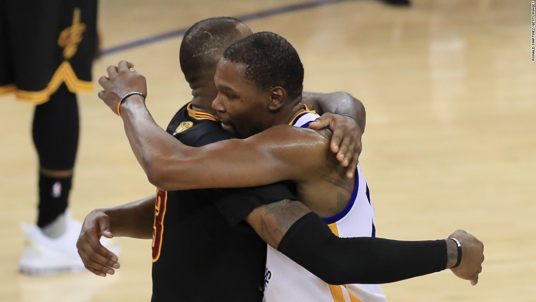 Durant hugs Cleveland star LeBron James after the game. James averaged a triple-double in the Finals: 33.6 points, 12 rebounds and 10 assists. He has played in the Finals each of the last seven seasons, with his team winning three of them.