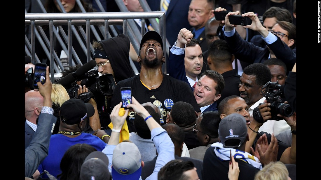 Durant is mobbed by photographers after the final buzzer.