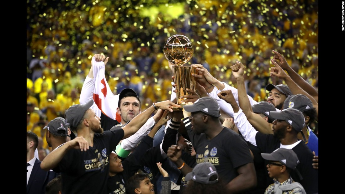 The Golden State Warriors celebrate with the Larry O'Brien Championship Trophy after winning Game 5 of the NBA Finals on Monday, June 12. Golden State won 129-120 to collect its second title in three years.