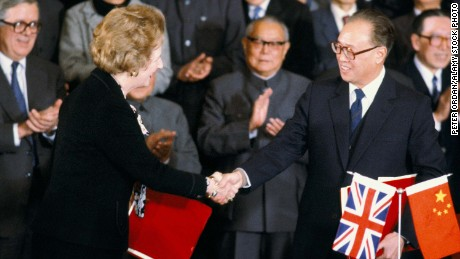British Prime Minister Margaret Thatcher shakes hands with Chinese Premier Zhao Ziyang after signing the Sino-British Joint Declaration on December 19, 1984.