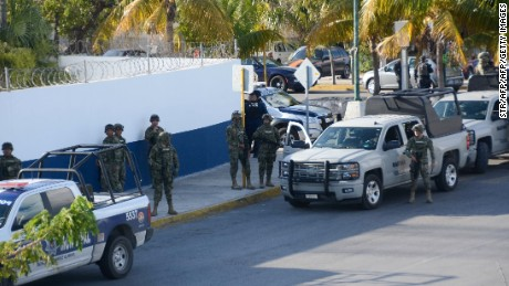 Mexican marines arrive at the place where a shooting erupted after an attack against the building of the Quintana Roo State Prosecution, in Cancun, Mexico, on January 17, 2017. The shooting happened as Mexican authorities investigate whether a feud over local drug sales was behind a nightclub shooting that killed three foreigners and two Mexicans at a popular beach resort. Monday's shooting at the Blue Parrot club during the BPM electronic music festival rocked Playa del Carmen, a usually peaceful Caribbean seaside town. / AFP / STR        (Photo credit should read STR/AFP/Getty Images)