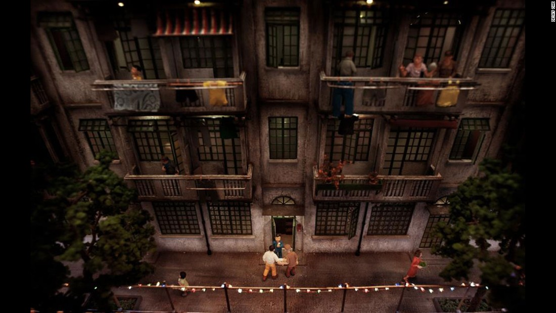 Miniature figurines and lights add life to this recreated residential building.