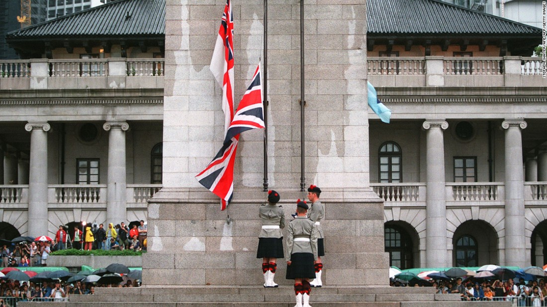 British soldiers lower the country's flag for the last time at the Cenotaph monument in central Hong Kong on June 30, 1997.