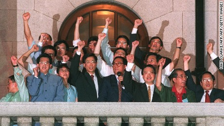 "Directly elected lawmakers addressed a crowd from a balcony of the city's parliament on July 1, 1997. The flames of democracy, they promised, would never be ""snuffed out."""