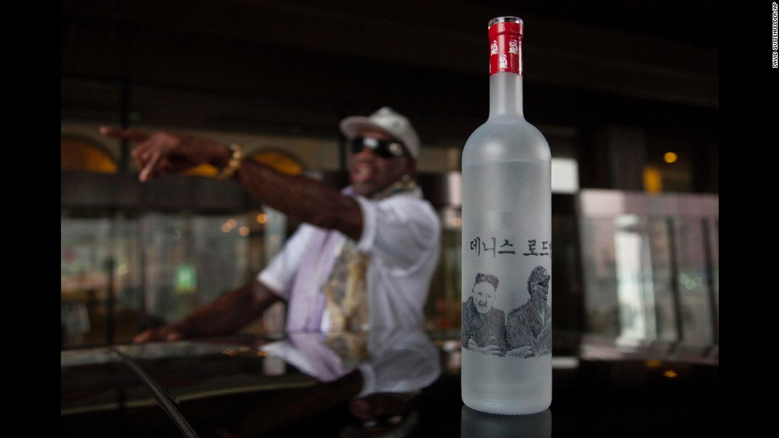 A bottle of vodka with illustrations of Rodman, Kim and Rodman's name written in Korean sits on the roof of a car outside a Pyongyang hotel in January 2014.