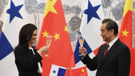 BEIJING, CHINA - JUNE 13:  Panama's Foreign Minister Isabel de Saint Malo and Chinese Foreign Minister Wang Yi drink a toast after signing a joint communique on establishing diplomatic relations during a press briefing on June 13, 2017 in Beijing, China (Photo by Greg Baker - Pool/Getty Images)