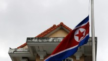 The North Korean national flag flutters at half mast at the North Korea embassy in Singapore on December 20, 2011.  North Korean leader Kim Jong-Il has died aged 69 of a heart attack, state media announced, plunging the nuclear-armed and deeply isolated nation into a second dynastic succession.       AFP PHOTO / SIMIN WANG (Photo credit should read SIMIN WANG/AFP/Getty Images)