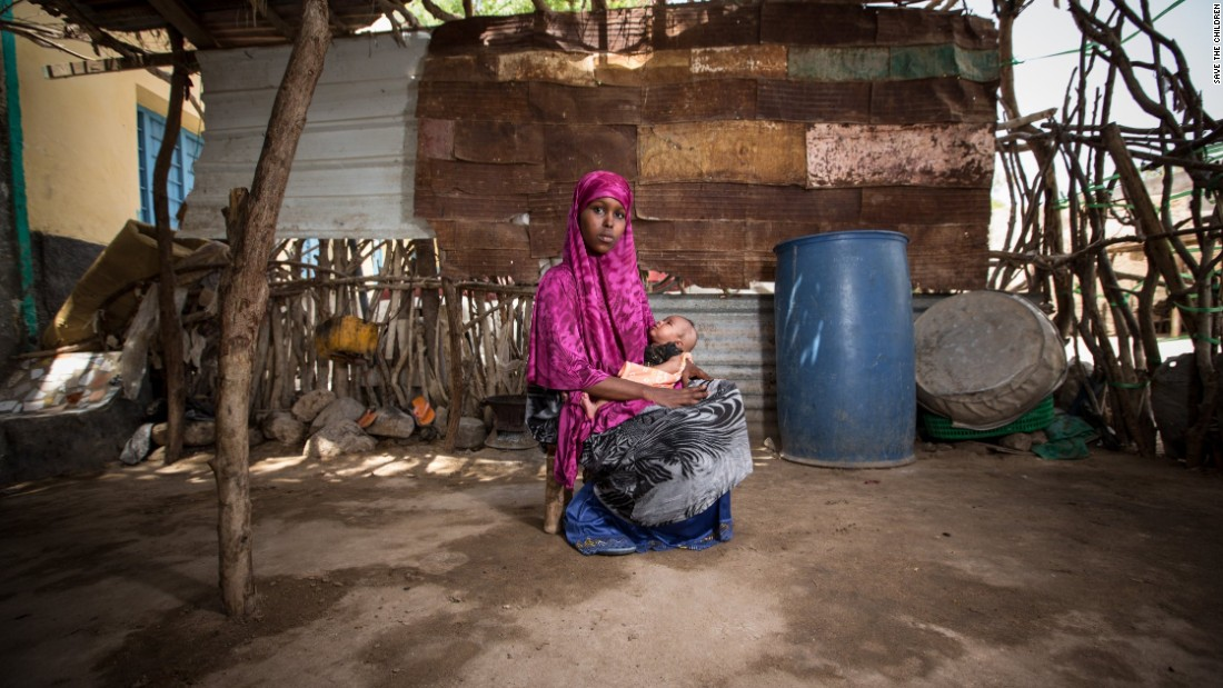 <strong>Somalia: </strong>A former child bride, now 16, holds her 2-month-old daughter outside her family's home. Somalia has an adolescent birth rate of 102.6 births per 1,000 girls 15 to 19. In the United States, that rate is 21.2 births per 1,000 girls. In Sweden, it's 5.7 births per 1,000 girls.