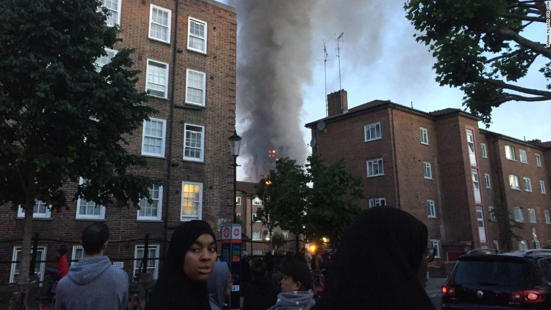 Terrified witnesses watch as building burns