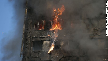 Fire rips through Grenfell Tower as firefighters attempt to control a huge blaze on June 14, 2017 in west London. 