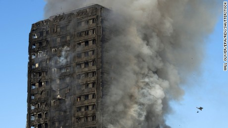 Mandatory Credit: Photo by WILL OLIVER/EPA/REX/Shutterstock (8866688ak) Smoke rises from the fire at the Grenfell Tower apartment block in North Kensington, London, Britain, 14 June 2017. According to the London Fire Brigade, 40 fire engines and 200 firefighters are working to put out the blaze. Residents in the tower were said to be evacuating and a number of people were treated for a 'range of injuries,' Metropolitan Police said. Fire at Lancaster West Estate in London, United Kingdom - 14 Jun 2017