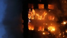 """Flames and smoke engulf Grenfell Tower, a residential block on June 14, 2017 in west London.  The massive fire ripped through the 27-storey apartment block in west London in the early hours of Wednesday, trapping residents inside as 200 firefighters battled the blaze. Police and fire services attempted to evacuate the concrete block and said """"a number of people are being treated for a range of injuries"""", including at least two for smoke inhalation.   / AFP PHOTO / Daniel LEAL-OLIVAS        (Photo credit should read DANIEL LEAL-OLIVAS/AFP/Getty Images)"""