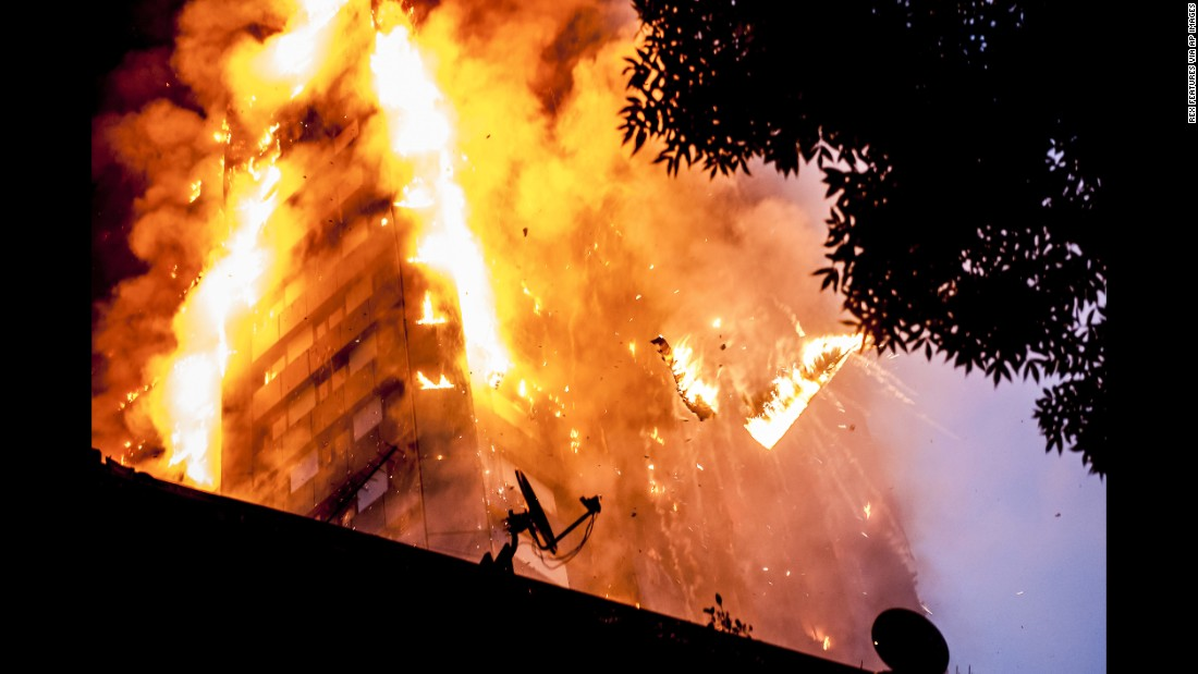Burning debris falls from the 24-story Grenfell Tower in the White City district of London as a massive fire engulfed the building early in the morning on Wednesday, June 14. London Mayor, Sadiq Khan, has declared the fire a major incident as more than 200 firefighters tackle the blaze and at least 50 people are receive hospital treatment.